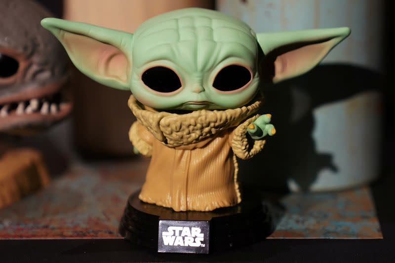 """A Baby Yoda toy is pictured during a """"Star Wars"""" advance product showcase in the Manhattan borough of New York City"""