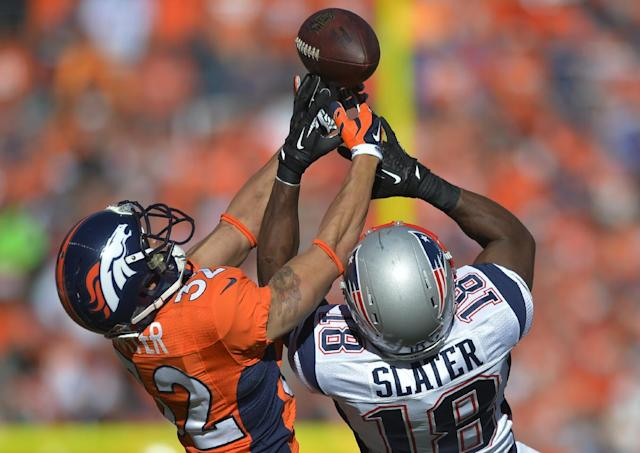 Denver Broncos cornerback Tony Carter (32) breaks up a pass intended for New England Patriots wide receiver Matthew Slater (18) during the first half of the AFC Championship NFL playoff football game in Denver, Sunday, Jan. 19, 2014. (AP Photo/Jack Dempsey)