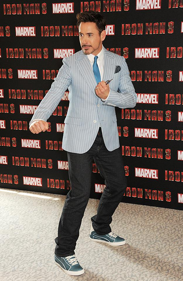 LONDON, ENGLAND - APRIL 17:  (EMBARGOED FOR PUBLICATION IN UK TABLOID NEWSPAPERS UNTIL 48 HOURS AFTER CREATE DATE AND TIME. MANDATORY CREDIT PHOTO BY DAVE M. BENETT/GETTY IMAGES REQUIRED)  Robert Downey Jr poses at the Iron Man 3 photocall at The Dorchester on April 17, 2013 in London, England.  (Photo by Dave M. Benett/Getty Images)