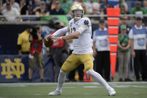 File-Notre Dame quarterback Ian Book (12) throws a pass during the first half of the Camping World Bowl NCAA college football game against Iowa State Saturday, Dec. 28, 2019, in Orlando, Fla. Head coach Brian Kelly has seen growth in the 6-foot, 208-pound Book since quarterbacks coach Tom Rees became the teams new offensive coordinator prior to the teams Camping World Bow victory over Iowa State. (AP Photo/Phelan M. Ebenhack, File)
