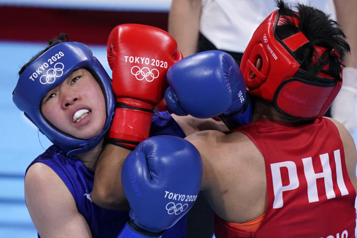 Philippines's Nesthy Petecio, right, exchanges punches with Japan's Sena Irie during their women's featherweight 60-kg final boxing match at the 2020 Summer Olympics, Tuesday, Aug. 3, 2021, in Tokyo, Japan. (AP Photo/Frank Franklin II)