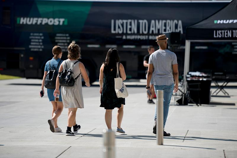 HuffPost staffers (from left to right: Christine Roberts, Melissa Radzimski, Emma Gray and Ja'han Jones) make their way to the bus activation site.