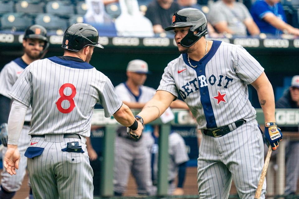 Robbie Grossman (left) of the Detroit Tigers celebrates with Miguel Cabrera after scoring the first run in the game against the Kansas City Royals in the first inning at Kauffman Stadium on May 23, 2021 in Kansas City, Missouri.