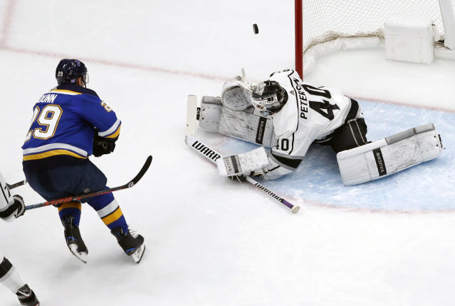 Los Angeles Kings goaltender Calvin Petersen (40) deflects a shot from St. Louis Blues' Vince Dunn (29) during the first period of an NHL hockey game Monday, Nov. 19, 2018, in St. Louis. (AP Photo/Jeff Roberson)