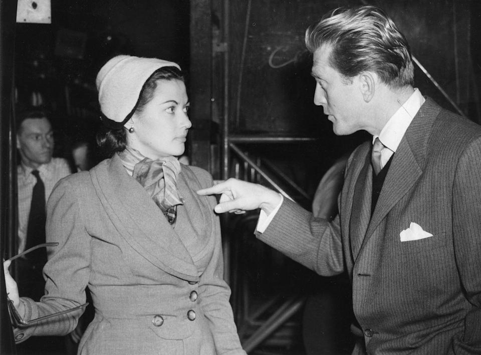 <p>Douglas and his costar Yvonne De Carlo rehearse backstage for their Royal Film Performance at the Empire Theater in London. </p>