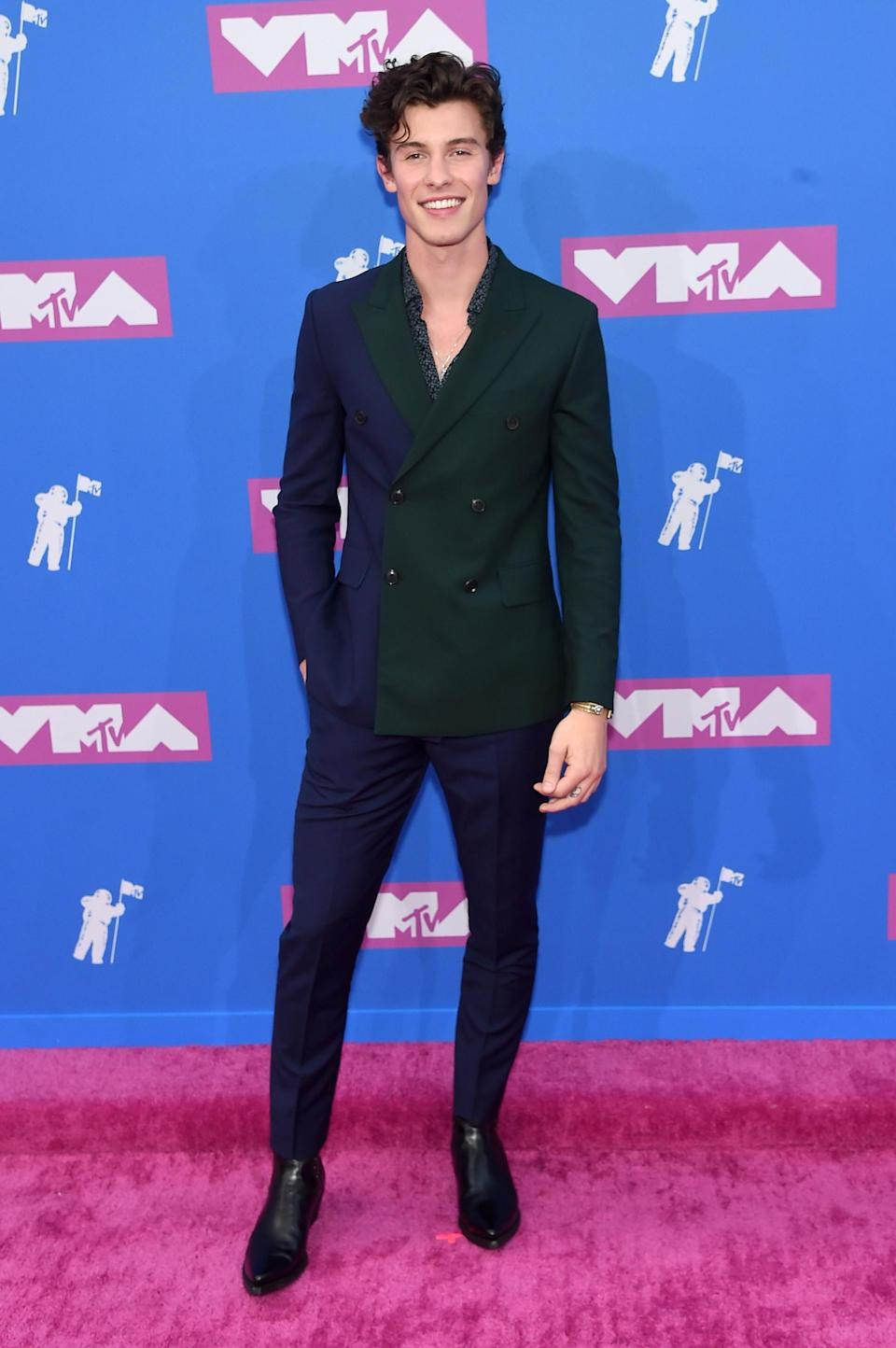 <p>The Canadian singer worked a two-tone suit by Paul Smith. <em>[Photo: Getty]</em> </p>