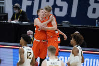 Syracuse's Buddy Boeheim (35) ad Marek Dolezaj (21) celebrate following a second-round game against West Virginia in the NCAA men's college basketball tournament at Bankers Life Fieldhouse, Sunday, March 21, 2021, in Indianapolis. Syracuse defeated Syracuse 75-72. (AP Photo/Darron Cummings)