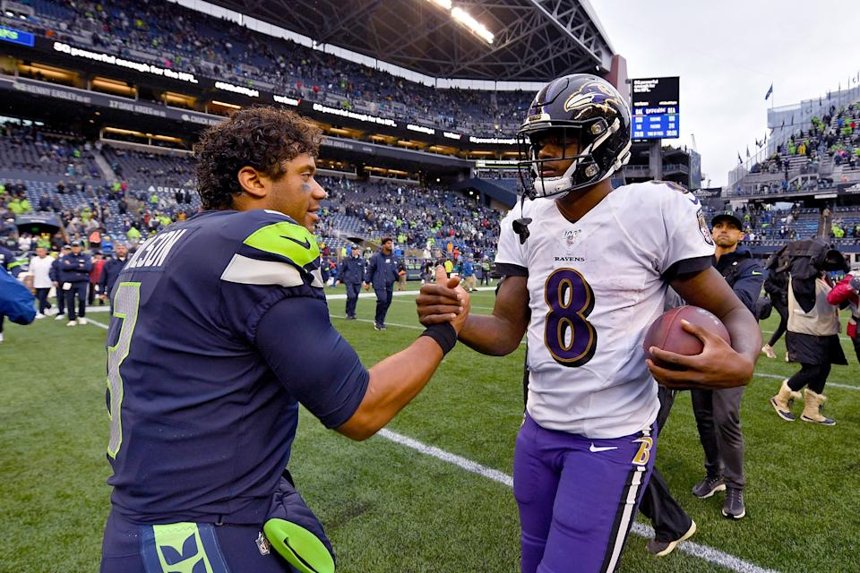 Russell Wilson and Lamar Jackson are two of the best quarterbacks remaining in the NFL playoffs. (Photo by Alika Jenner/Getty Images)