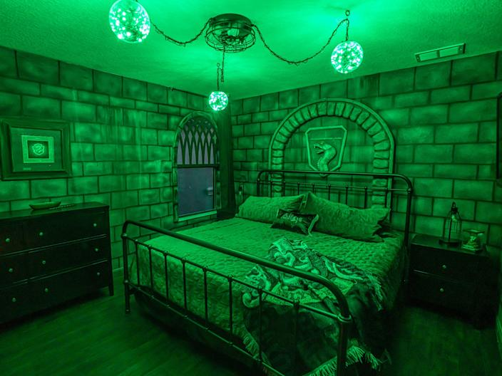 The Slytherin room features plenty of green accents.