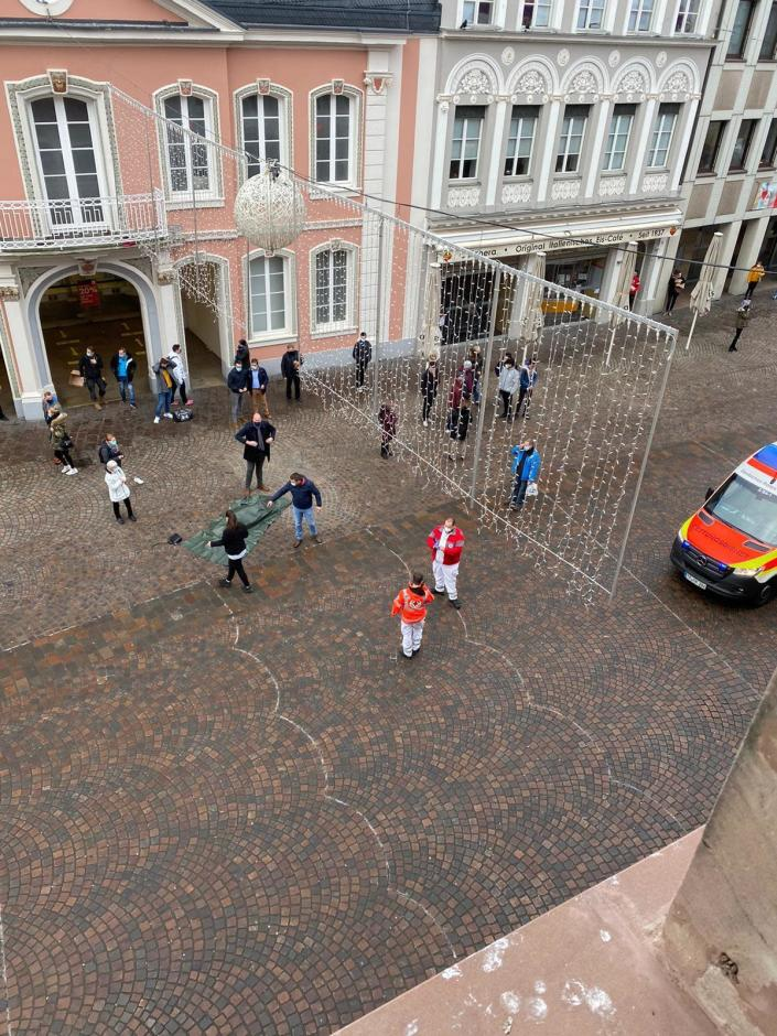 Rescue workers are pictured in the city of Trier, Germany, Tuesday, Dec 1, 2020. German police say two people have been killed and several others injured in the southwestern German city of Trier when a car drove into a pedestrian zone. Trier police tweeted that the driver had been arrested and the vehicle impounded. (AP Photo/Sebastian Schmitz, lokalo.de)