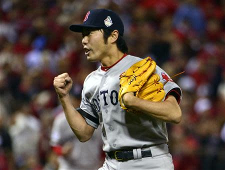 Oct 28, 2013; St. Louis, MO, USA; Boston Red Sox relief pitcher Koji Uehara (19) celebrates after game five of the MLB baseball World Series against the St. Louis Cardinals at Busch Stadium. REUTERS
