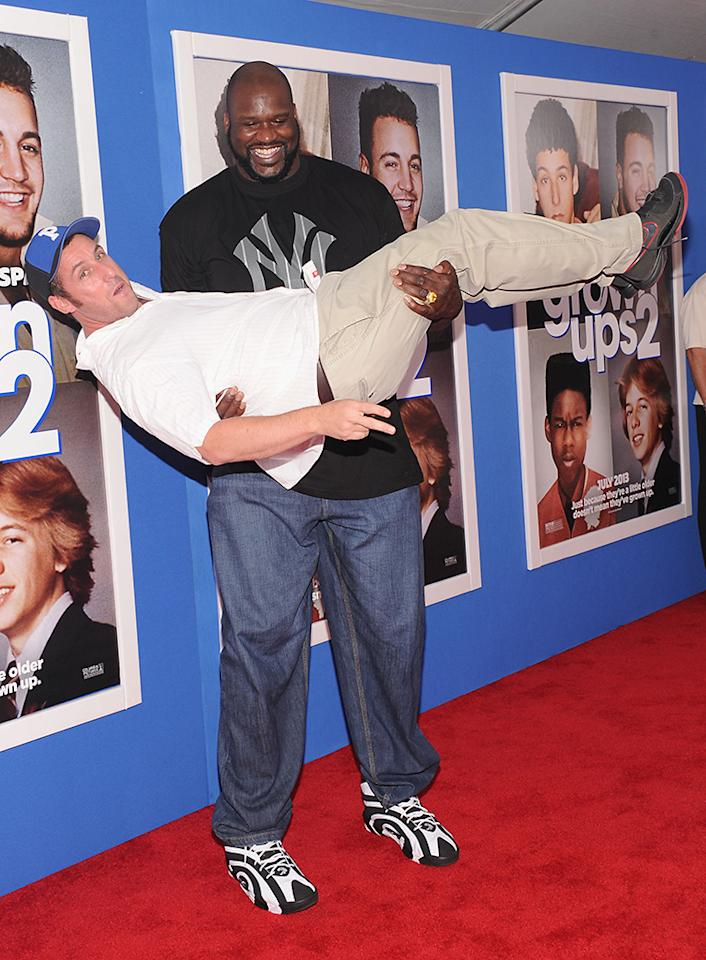 """NEW YORK, NY - JULY 10:  Actors Adam Sandler (L) and Shaquille O'Neal attend the """"Grown Ups 2"""" New York Premiere at AMC Lincoln Square Theater on July 10, 2013 in New York City.  (Photo by Jamie McCarthy/Getty Images)"""