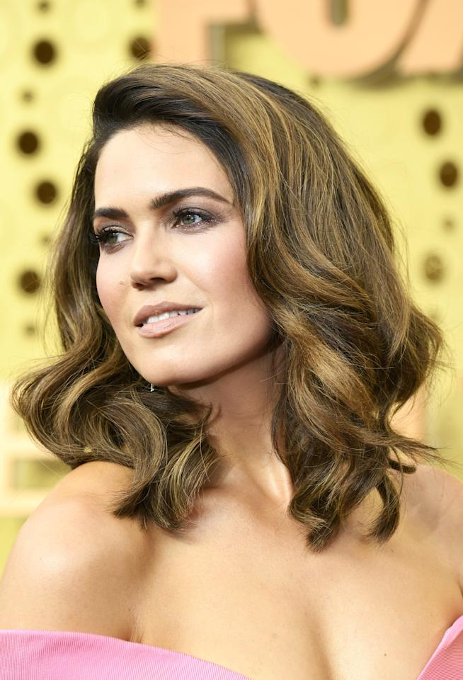 "The Emmys might be a celebration of TV, but this is the epitome of old-Hollywood movie-star hair. Moore's hairstylist Ashley Streicher used <a href=""https://www.amazon.com/Garnier-Fructis-Lifting-Spray-Mousse/dp/B00TQ2M5ME/ref=sr_1_4?keywords=Garnier%20Fructis%20Style%20Root%20Amp%20Lifting%20Mousse&qid=1569206096&s=beauty&sr=1-4"" rel=""nofollow"">Garnier Fructis Style Root Amp Lifting Mousse</a> and <a href=""https://www.target.com/p/garnier-fructis-style-flexible-control-hairspray-8-25-oz/-/A-12443659?ref=tgt_adv_XS000000&AFID=google_pla_df&fndsrc=tgtao&CPNG=PLA_Beauty%2bPersonal%20Care%2bShopping_Local&adgroup=SC_Health%2bBeauty&LID=700000001170770pgs&network=g&device=c&location=9067609&ds_rl=1246978&ds_rl=1247077&ds_rl=1246978&gclid=EAIaIQobChMI6ZDVsfTl5AIVRJyzCh3L_gQpEAQYASABEgKfd_D_BwE&gclsrc=aw.ds"" rel=""nofollow"">Flexible Hold Hairspray</a> to get this Cindy Crawford–inspired look."