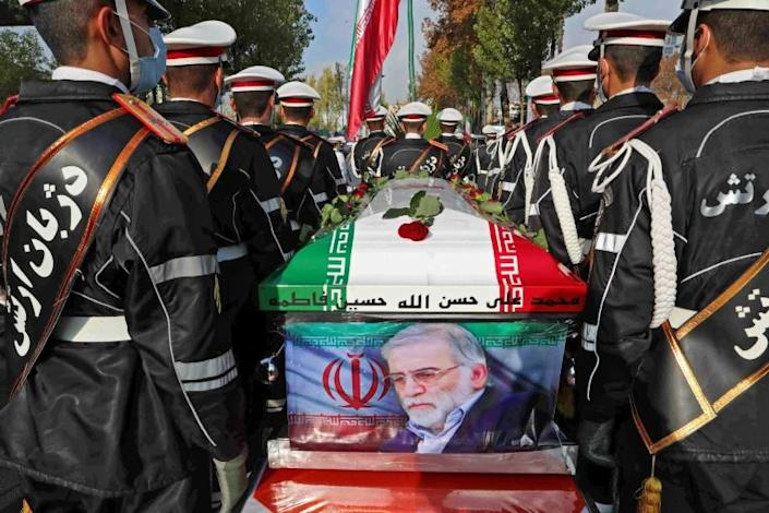 Mohsen Fakhrizadeh's coffin, draped in the Iranian flag and with a photo of the assassinated nuclear scientist