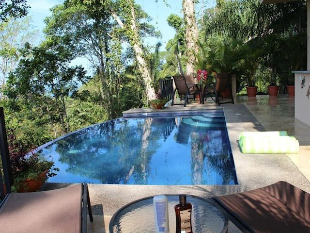 Known as the Flying Monkey Villa, this property is nestled in the jungle and provides stunning panoramic ocean and jungle views. The infinity pool from the lower level includes a built-in custom outdoor wet bar, too.<span>Check it out</span>.