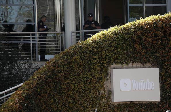 Police officers stand by in front of the YouTube headquarters on April 3, 2018 in San Bruno, Calif. Police are investigating an active shooter incident at YouTube headquarters that left at least one person dead and several wounded. (Photo by Justin Sullivan/Getty Images)