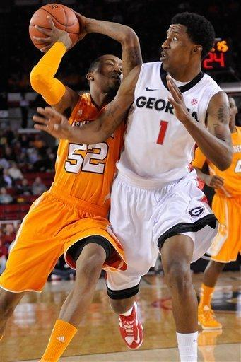 Tennessee guard Jordan McRae (52) drives while being defended by Georgia guard Kentavious Caldwell-Pope (1)during the first half of an NCAA college basketball game in Athens, Ga., Saturday, March 2, 2013. (AP Photo/The Athens Banner-Herald, AJ Reynolds)