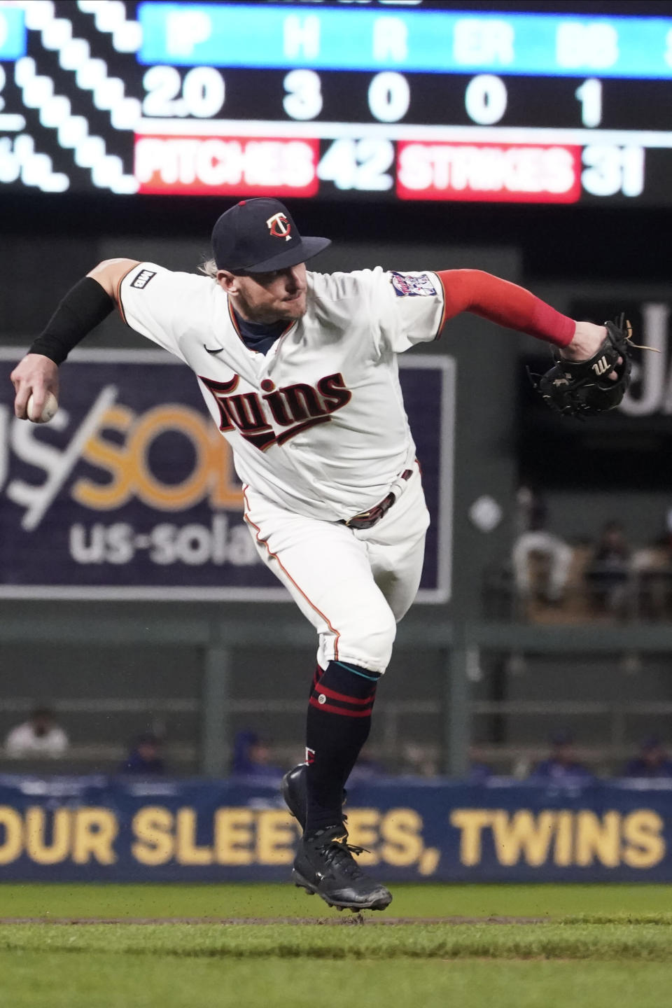 Minnesota Twins third baseman Josh Donaldson fields a grounder by Toronto Blue Jays' Vladimir Guerrero Jr. who beats the throw for a single in the second inning of a baseball game, Thursday, Sept. 23, 2021, in Minneapolis. (AP Photo/Jim Mone)