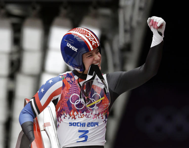 Kate Hansen of the United States waves to supporters after finishing her first run during the women's singles luge competition at the 2014 Winter Olympics, Monday, Feb. 10, 2014, in Krasnaya Polyana, Russia. (AP Photo/Dita Alangkara)