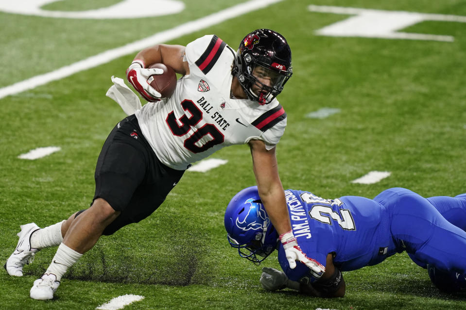 Ball State running back Tye Evans (30) rushes during the first half of the Mid-American Conference championship NCAA college football game, Friday, Dec. 18, 2020, in Detroit. (AP Photo/Carlos Osorio)