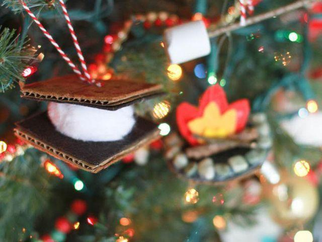 """<p>Create a picturesque camping scene with s'more ornaments, made using felt, cardboard, cotton balls, and a foam """"marshmallow.""""</p><p><strong>Get the tutorial at <a href=""""http://www.kellehampton.com/2013/12/friday-faves-gone-camping-ornaments-diy.html"""" rel=""""nofollow noopener"""" target=""""_blank"""" data-ylk=""""slk:Enjoying The Small Things"""" class=""""link rapid-noclick-resp"""">Enjoying The Small Things</a>.</strong></p>"""