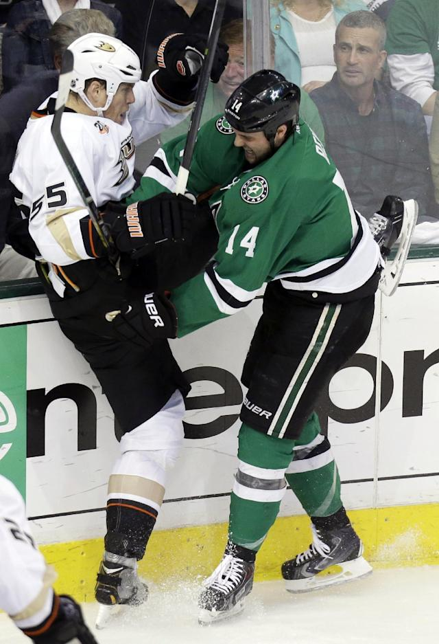 Anaheim Ducks defenseman Bryan Allen (55) and Dallas Stars left wing Jamie Benn (14) tangle against the boards during the first period of Game 6 of a first-round NHL hockey playoff series in Dallas, Sunday, April 27, 2014. (AP Photo/LM Otero)