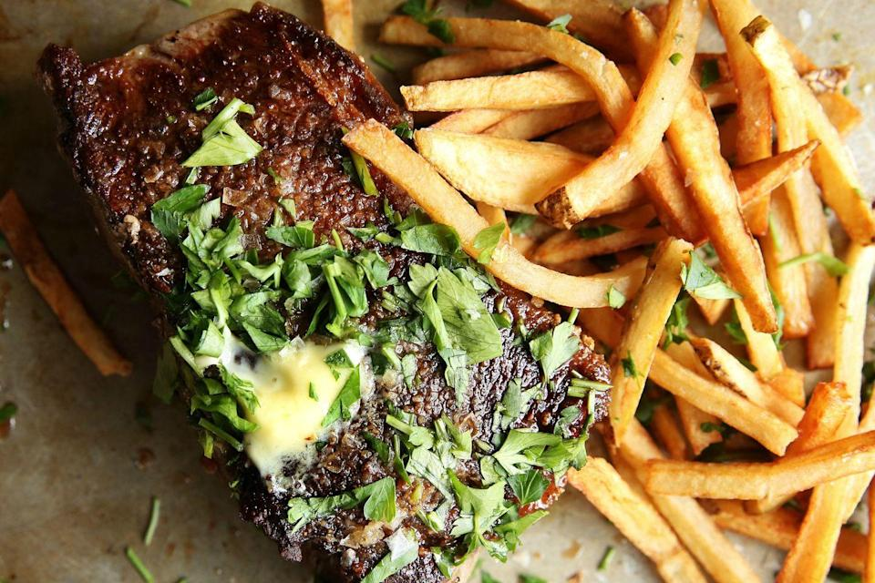 """<p>Anything a steakhouse can do, you can do better.</p><p>Get the recipe from <a href=""""https://www.delish.com/cooking/recipe-ideas/recipes/a46598/steak-frites-recipe/"""" rel=""""nofollow noopener"""" target=""""_blank"""" data-ylk=""""slk:Delish"""" class=""""link rapid-noclick-resp"""">Delish</a>.</p>"""