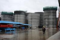 Oil tanks are shown under construction at a China National Petroleum Coporation site in Myanmar, June 1, 2012. The Asian country's ascendence to the top of the world's net oil import rankings will have profound impact, an article carried by the China Business News said