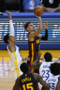 Atlanta Hawks guard Trae Young (11) shoots over Golden State Warriors forward Draymond Green (23) during the first half of an NBA basketball game in San Francisco, Friday, March 26, 2021. (AP Photo/Tony Avelar)