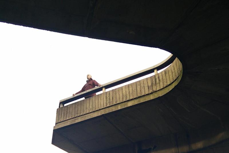 Island life: Charlie Warde, who is creating an immersive installation of a JG Ballard novel, stands on Westway flyover