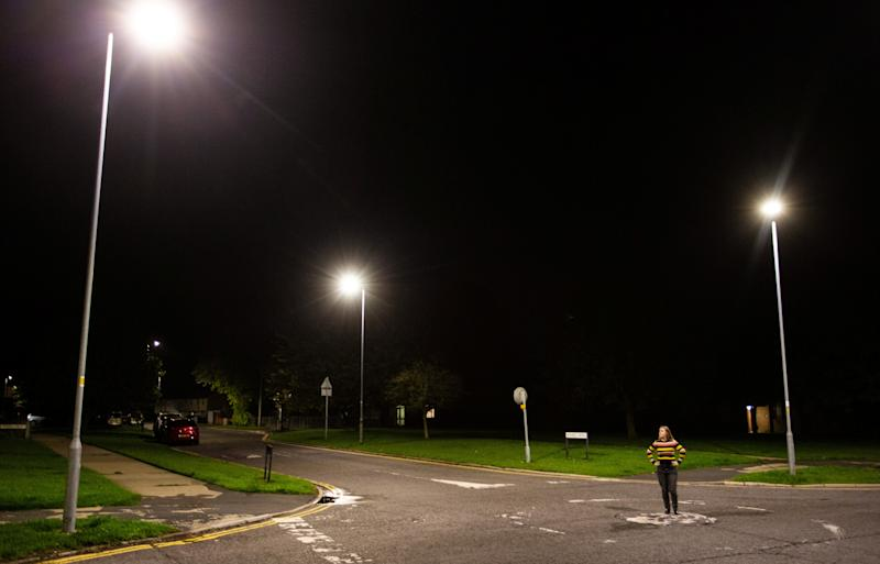 A pedestrian looks up at the new street lights in Swindon have been keeping some residents up at night. (SWNS)