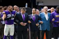 Sep 24, 2017; Minneapolis, MN, USA; Minnesota Vikings defensive back Harrison Smith (22) locks arms with general manager Rick Spielman (left) and owner Mark Wilf (middle) and owner Ziggy Wilf (right) before the game against the Tampa Bay Buccaneers at U.S. Bank Stadium. Mandatory Credit: Brad Rempel-USA TODAY Sports
