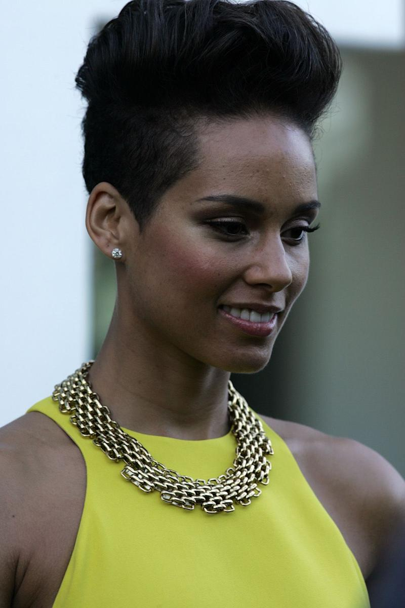 Age has nothing on Alicia Keys as she looks breath-taking in a long yellow dress/