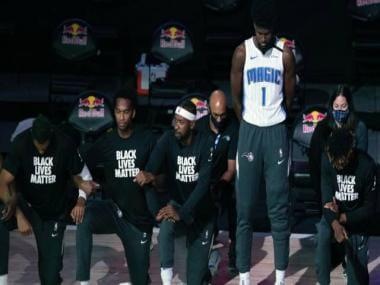 NBA: Gregg Popovich, Jonathan Isaac, Becky Hammon choose to stand for anthem in bubble