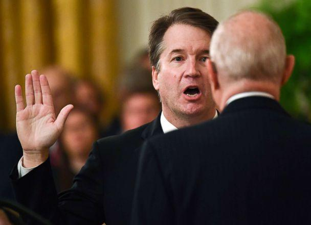 PHOTO: Brett Kavanaugh (L) is sworn-in as Associate Justice of the US Supreme Court by retired Associate Justice Anthony Kennedy at the White House, Oct. 8, 2018. (Brendan Smialowski/AFP via Getty Images)
