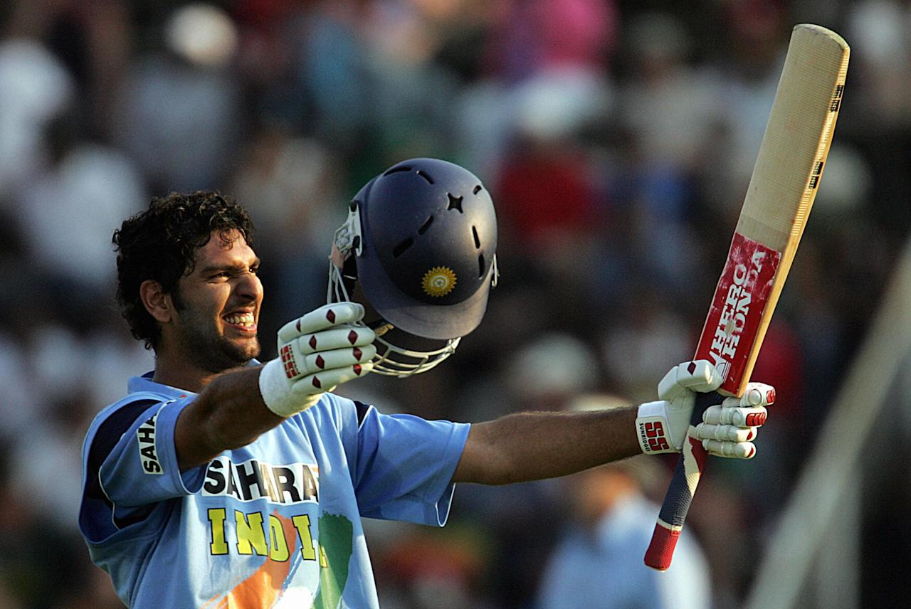 Harare, ZIMBABWE:  India's batsman Yuvraj Singh celabrates his 100th run 04 September 2005, in Harare during the sixth one day International (ODI) Triangular series, between India, New Zealand and hosts Zimbabwe. AFP PHOTO / ALEXANDER JOE  (Photo credit should read ALEXANDER JOE/AFP/Getty Images)
