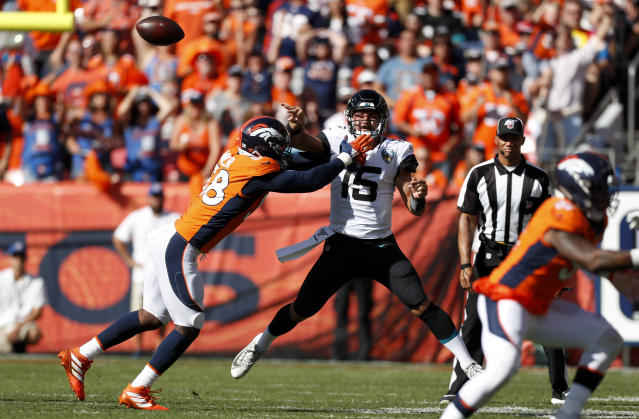 FILE - In this Sept. 29, 2019, file photo, Jacksonville Jaguars quarterback Gardner Minshew (15) throws a pass under pressure from Denver Broncos outside linebacker Von Miller, left, during the first half of an NFL football game in Denver. Denver has lost both home games on last-second field goals. ... One way to turn that around would be for star linebacker Miller to start getting to quarterbacks. Miller has 10 sacks in his last 10 home games but just two sacks this season. (AP Photo/David Zalubowski, File)