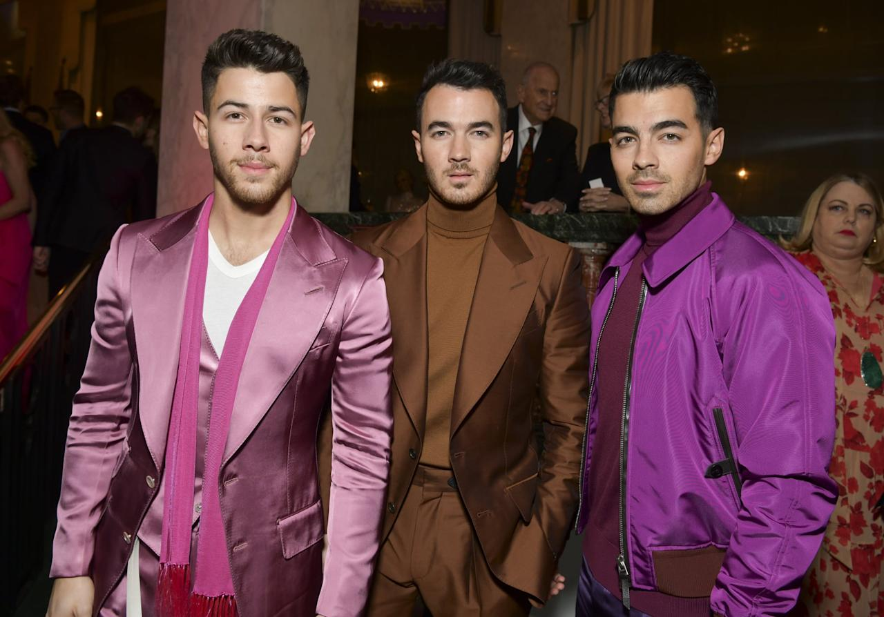 """<p>We love a good coordinated moment! Nick, Kevin, and <span class=""""nofilter"""">Joe Jonas</span> all opted for sleek silk separates in fun hues during an event in Beverly Hills.</p>"""