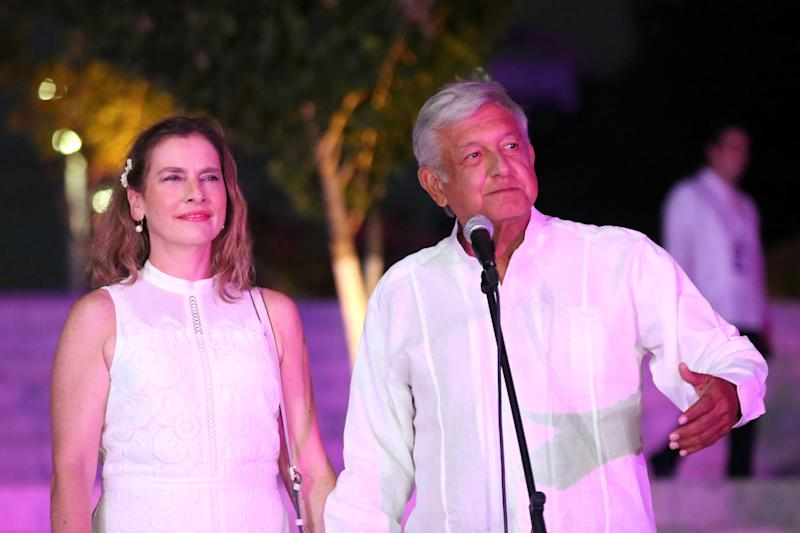 Leftist front-runner Andres Manuel Lopez Obrador of the National Regeneration Movement (MORENA), accompanied by his wife Beatriz Gutierrez Muller, delivers a message after arriving at the third and final debate in Merida