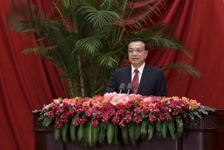 China's Premier Li delivers a speech at a reception marking China's 66th National Day in Beijing
