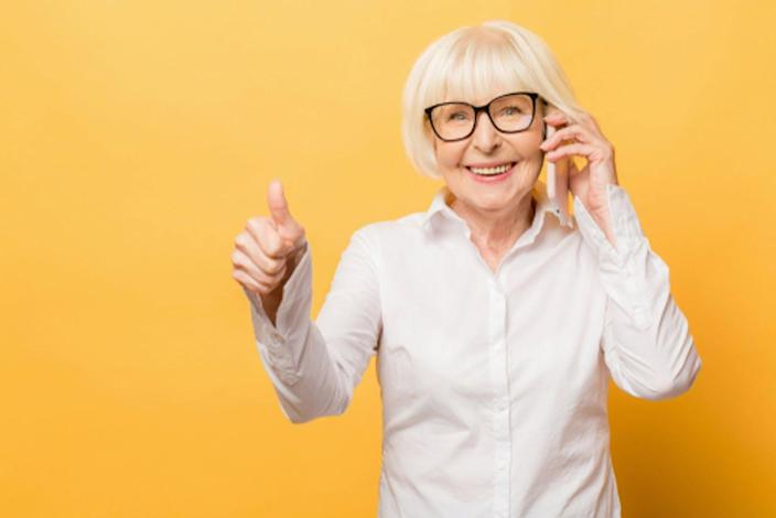 """<span class=""""caption"""">Standing up when doing routine things such as talking on the phone can reduce the amount of time a person sits. </span> <span class=""""attribution""""><a class=""""link rapid-noclick-resp"""" href=""""https://www.shutterstock.com/image-photo/phone-conversation-positive-aged-woman-smiling-1266156466?src=n0Yf05XgqvBzj3FoJcon2g-1-8"""" rel=""""nofollow noopener"""" target=""""_blank"""" data-ylk=""""slk:YoloStock/Shutterstock.com"""">YoloStock/Shutterstock.com</a></span>"""