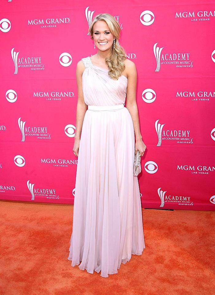 "Carrie Underwood arrived at the 44th annual Academy of Country Music Awards in Las Vegas in a gorgeous goddess gown -- the first of several looks the singer wore throughout the evening. Underwood was named entertainer of the year - the first female act to win the award since the Dixie Chicks did back in 2000. Jason Merritt/<a href=""http://www.gettyimages.com/"" target=""new"">GettyImages.com</a> - April 5, 2009"