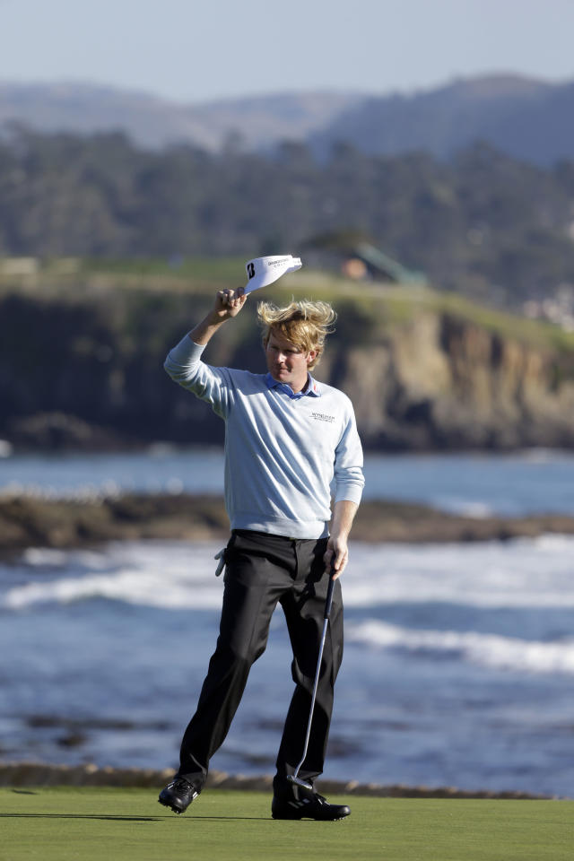 Brandt Snedeker raises his visor on the 18th green of the Pebble Beach Golf Course after winning the AT&T Pebble Beach Pro-Am golf tournament Sunday, Feb. 10, 2013, in Pebble Beach, Calif. (AP Photo/Eric Risberg)