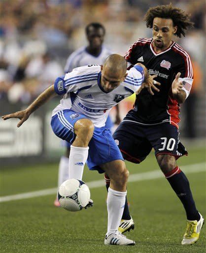 Montreal Impact forward Marco Di Vaio, left, vies for control of the ball with New England Revolution defender Kevin Alston (30) during the second half of an MLS soccer match in Foxborough, Mass., Sunday, Aug. 12, 2012. Impact won 1-0. (AP Photo/Steven Senne)