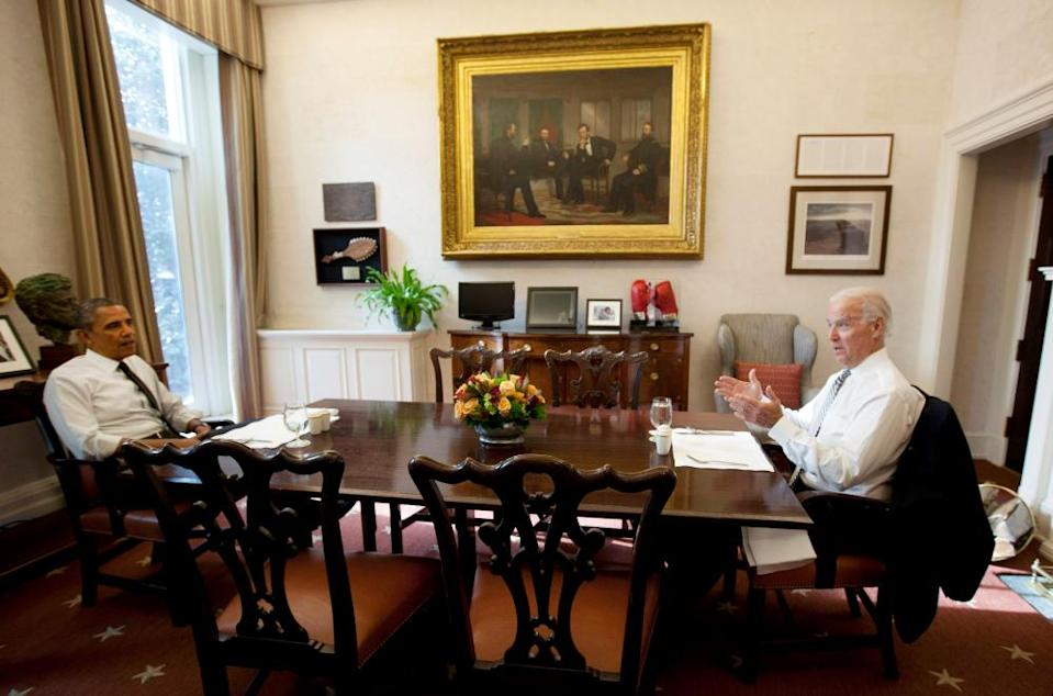 Barack Obama and Joe Biden meet for lunch in the White House on 8 January 2014.