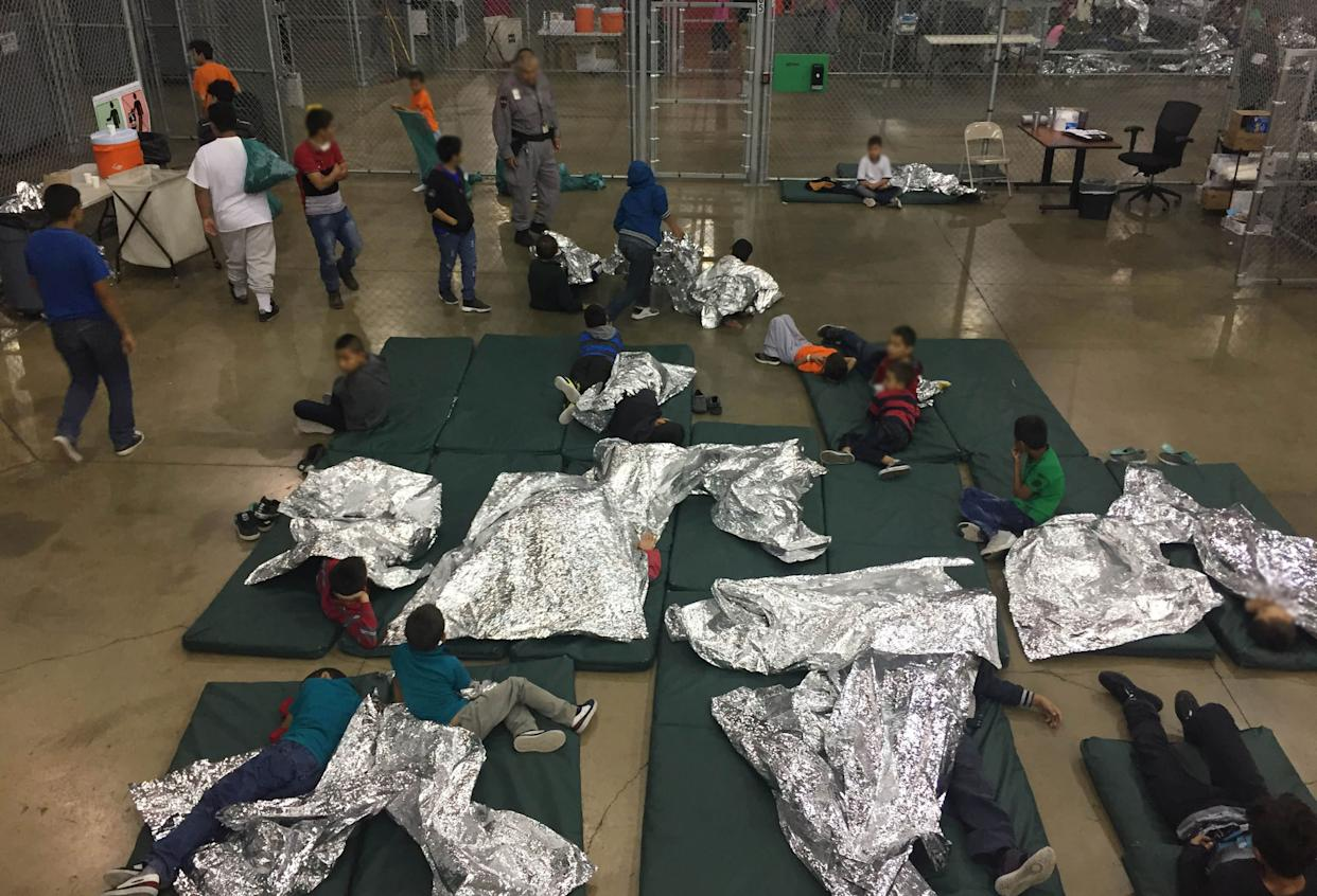 Children lie on sleeping pads with space blankets at the Rio Grande Valley Centralized Processing Center in Rio Grande City, Texas. (Photo: CBP/Handout via Reuters)