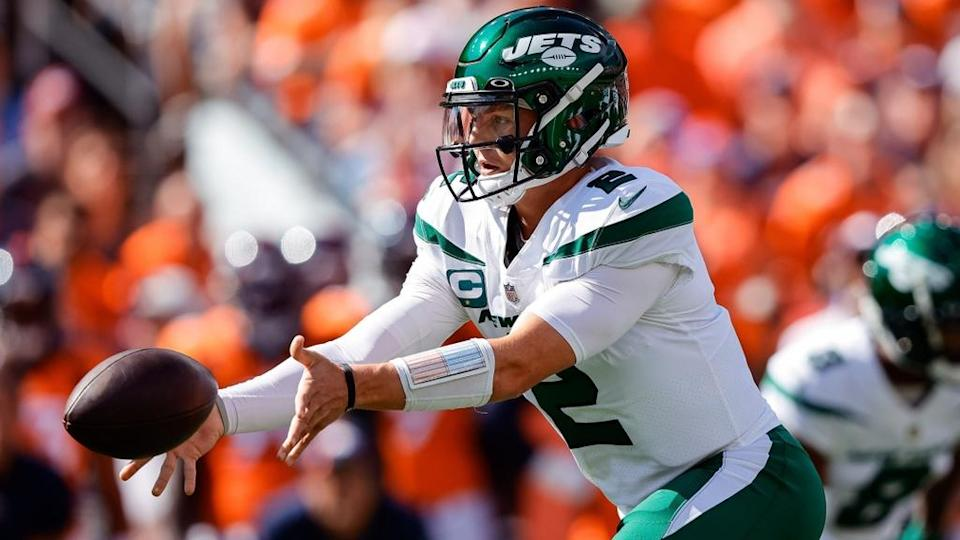Sep 26, 2021; Denver, Colorado, USA; New York Jets quarterback Zach Wilson (2) passes the ball in the first quarter against the Denver Broncos at Empower Field at Mile High.