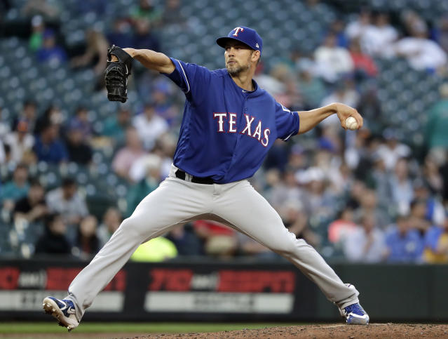 Texas Rangers starting pitcher Mike Minor throws to a Seattle Mariners batter during the third inning of a baseball game Tuesday, May 15, 2018, in Seattle. (AP Photo/Elaine Thompson)