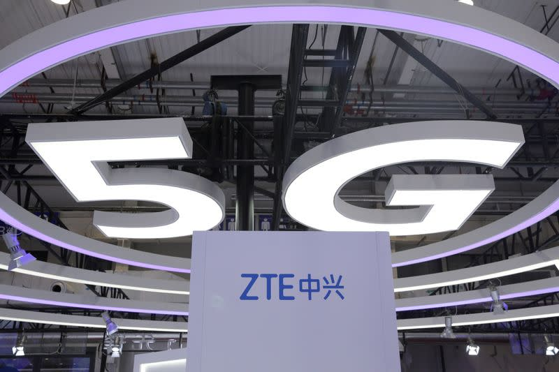 FILE PHOTO: The logo for ZTE, a popular pick among Korean investors, and a sign for 5G are seen at the World 5G Exhibition in Beijing