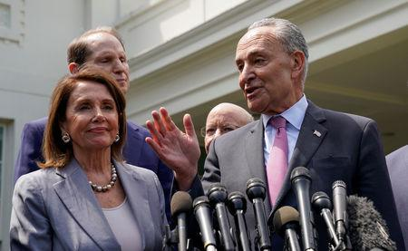 FILE PHOTO: U.S. House Speaker Nancy Pelosi and Senate Democratic Leader Chuck Schumer speak to reporters after their meeting on infrastructure with U.S. President Donald Trump, at the White House in Washington